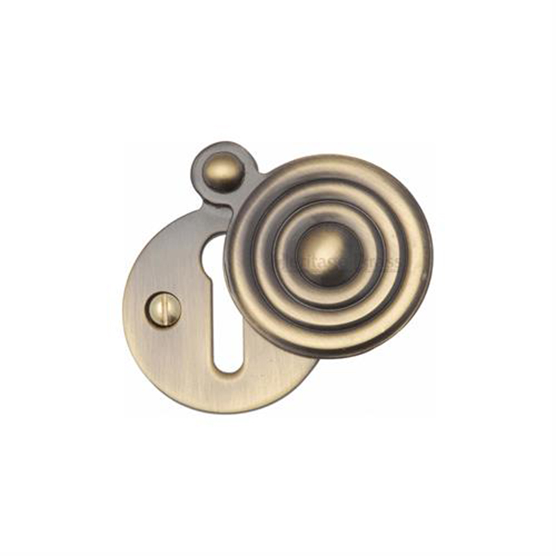 Reeded Covered Keyhole Escutcheon Antique Brass